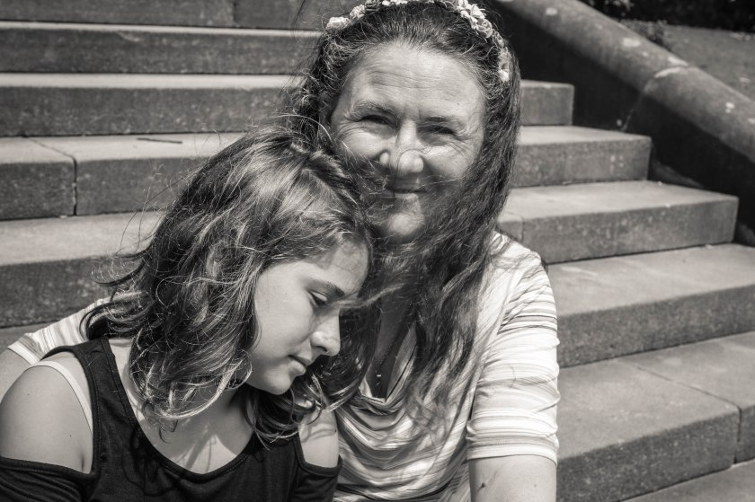 Mother and tween daughter sit on the steps by Sharon Troy-Baldwin Documentary Family Photography