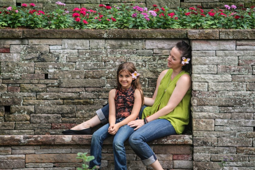 Mum and daughter with flowers in their hair by Sharon Troy-Baldwin Documentary Family Photography